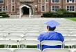 Graduate sitting alone --- Image by © Sean De Burca/Corbis